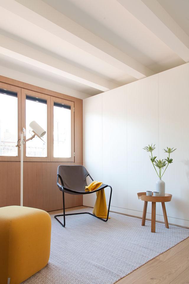 Zona de estar en la reforma de un mini apartamento