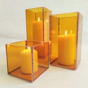 Conjunto de portavelas vidrio ámbar
